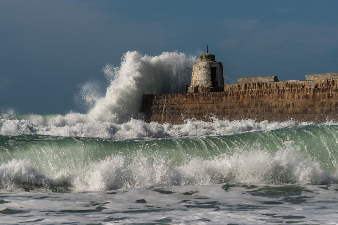 Waves crashing over the Monkey House, Portreath