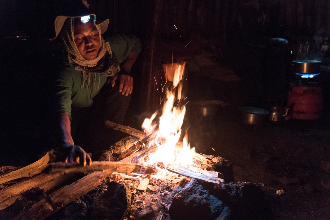 Camp fire in a tukul at Sankaber, Simien Mountains, Ethiopia