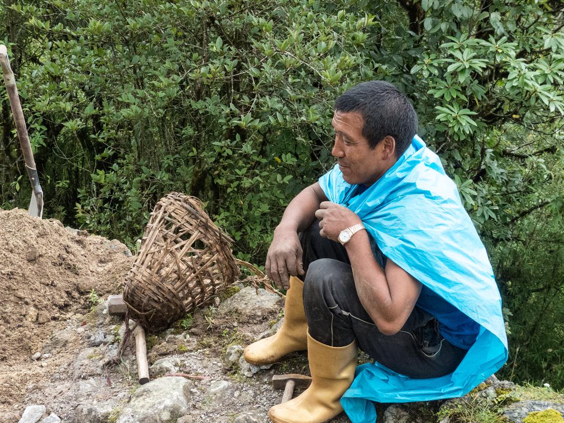 Road repair man, Nepal